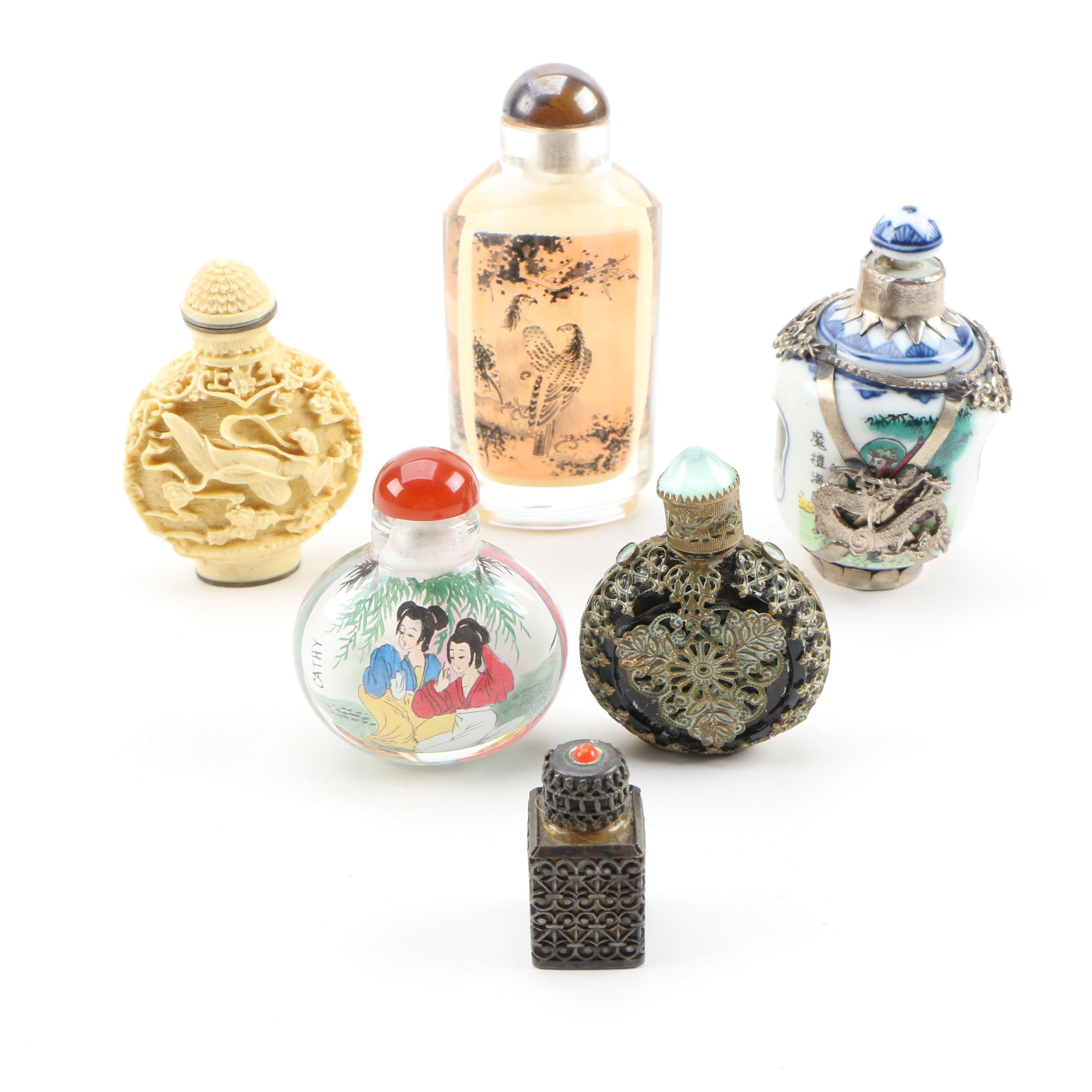 Snuff Bottle Assortment Including Reverse Painted Glass and Rotating Porcelain