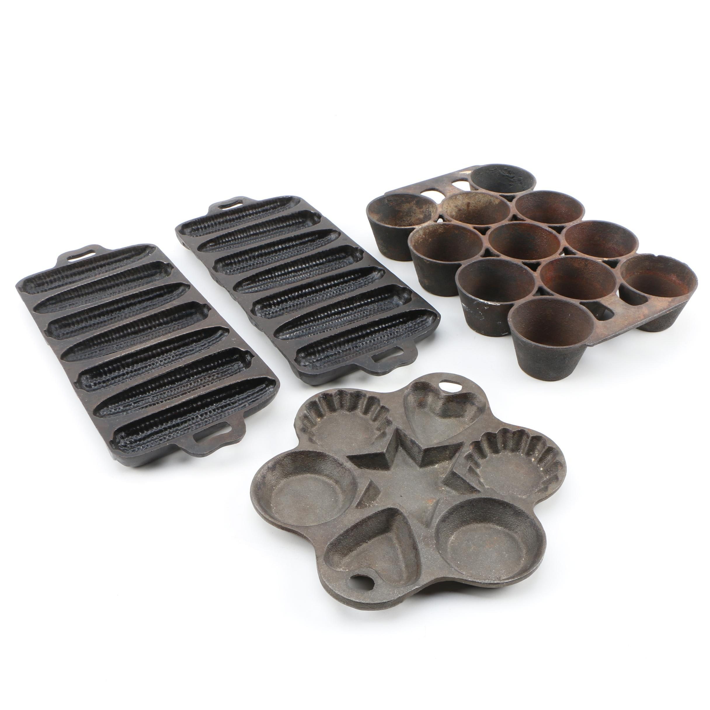 Griswold Cast Iron Muffin Tin, 1880-1907 with other Cast Iron Molds