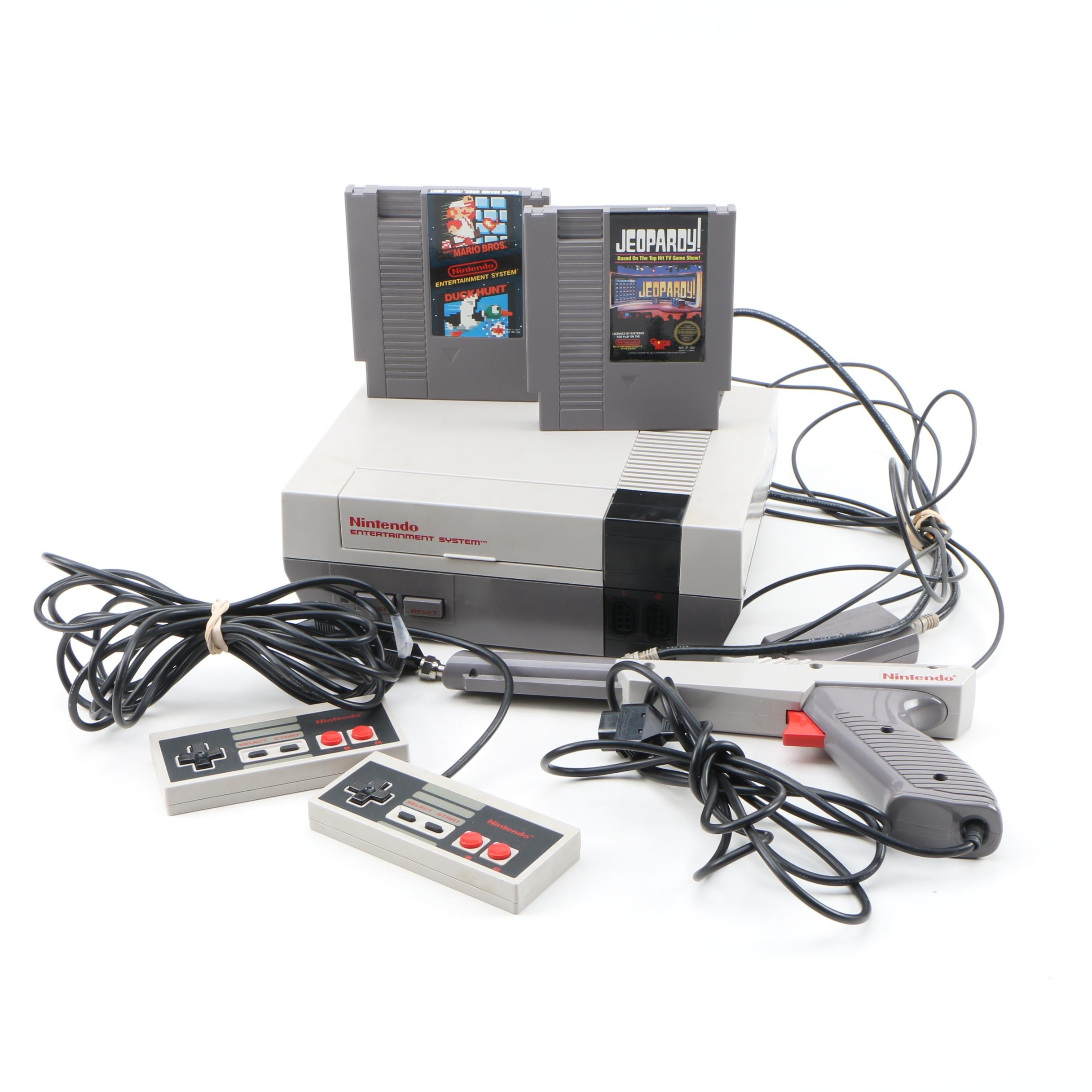 Nintendo Entertainment System with Controllers and Games