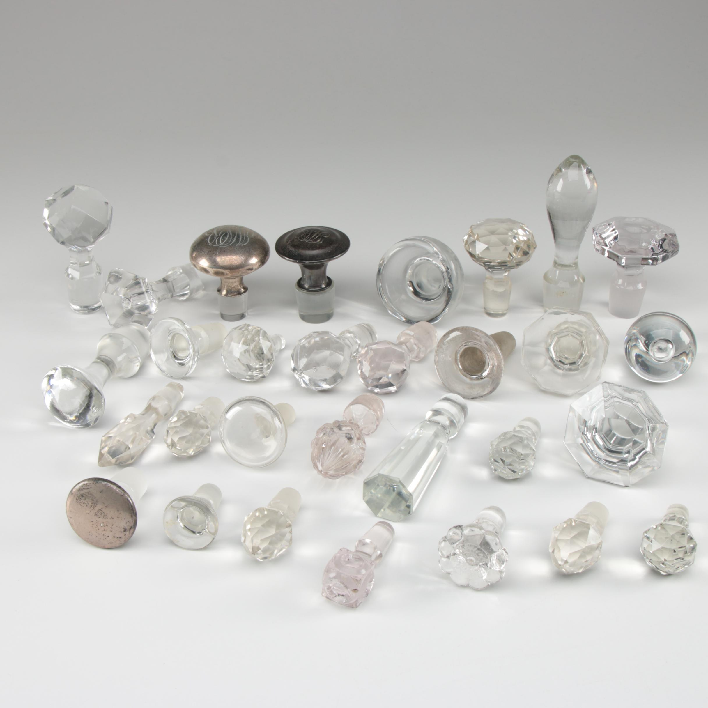 Cut Glass and Sterling Decanter Stoppers