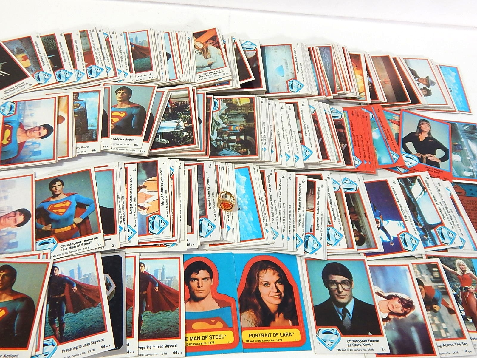 1978 DC Comics Superman Trading Cards with 1976 Superman Ring