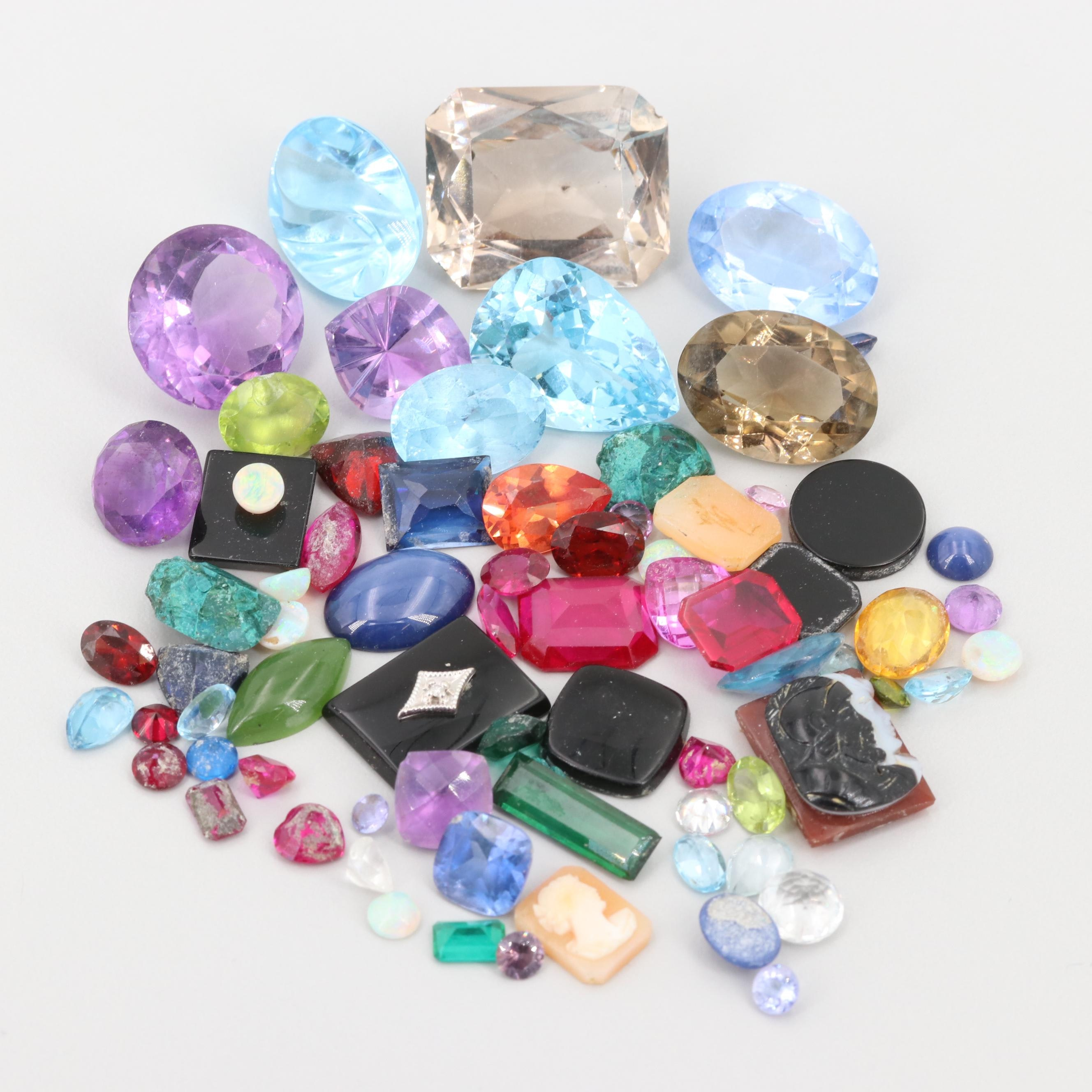Loose 2.36.25 CTW Gemstone Assortment Including Diamond, Synthetic Ruby and 10K