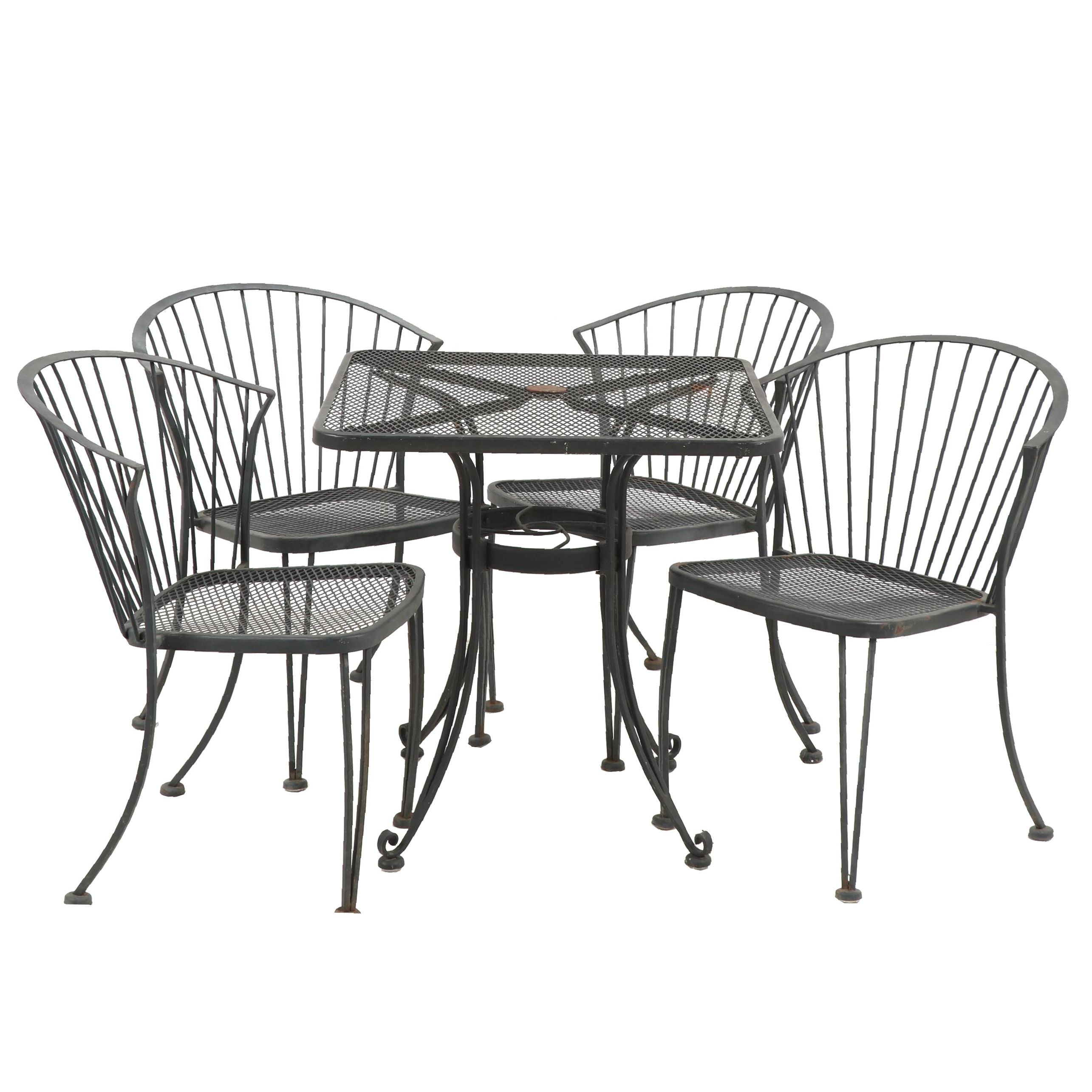 Four Metal Patio Chairs and Table
