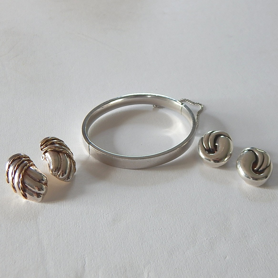 Sterling Silver Hinged Bracelet and Two Pair Clip Earrings