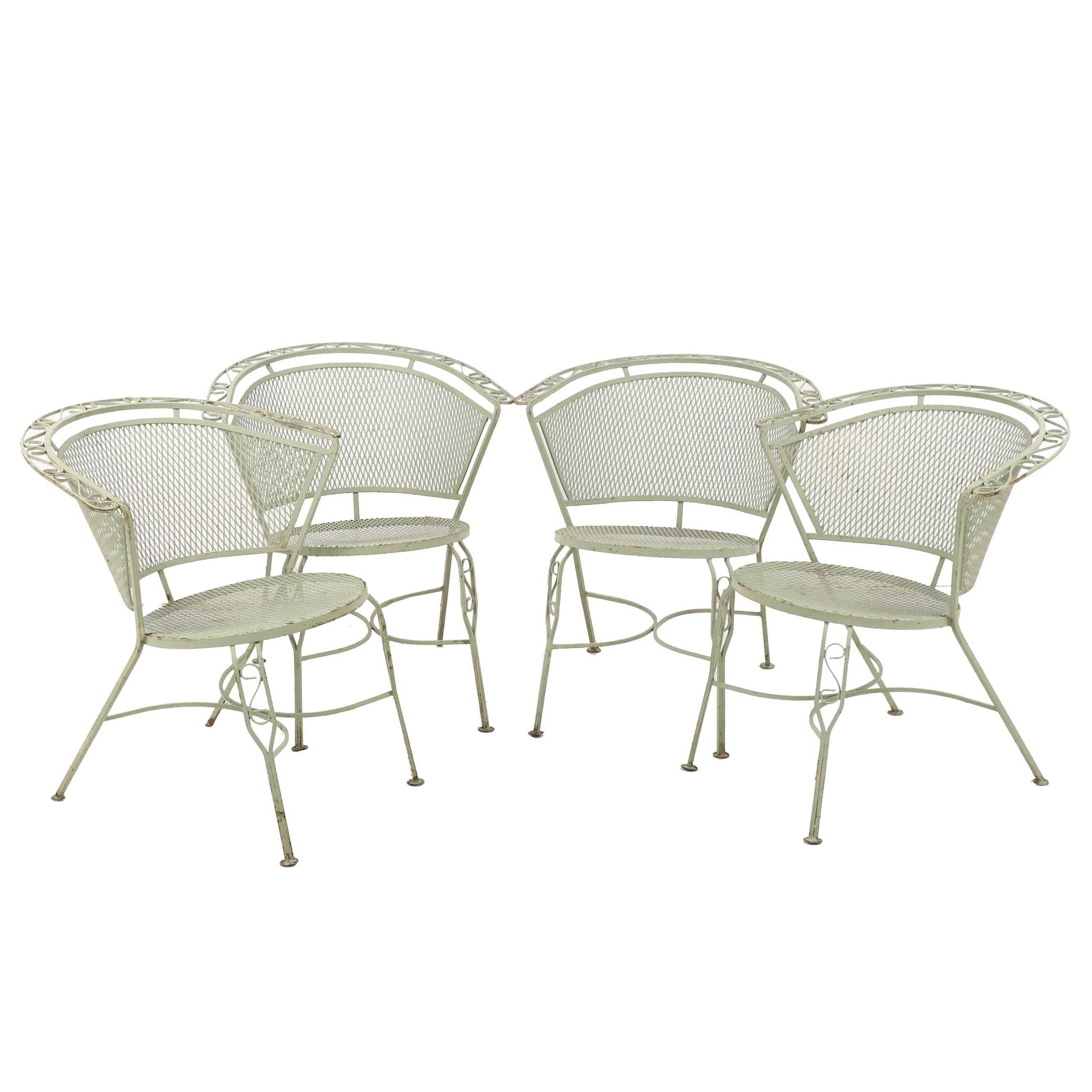Four Green Metal Patio Chairs