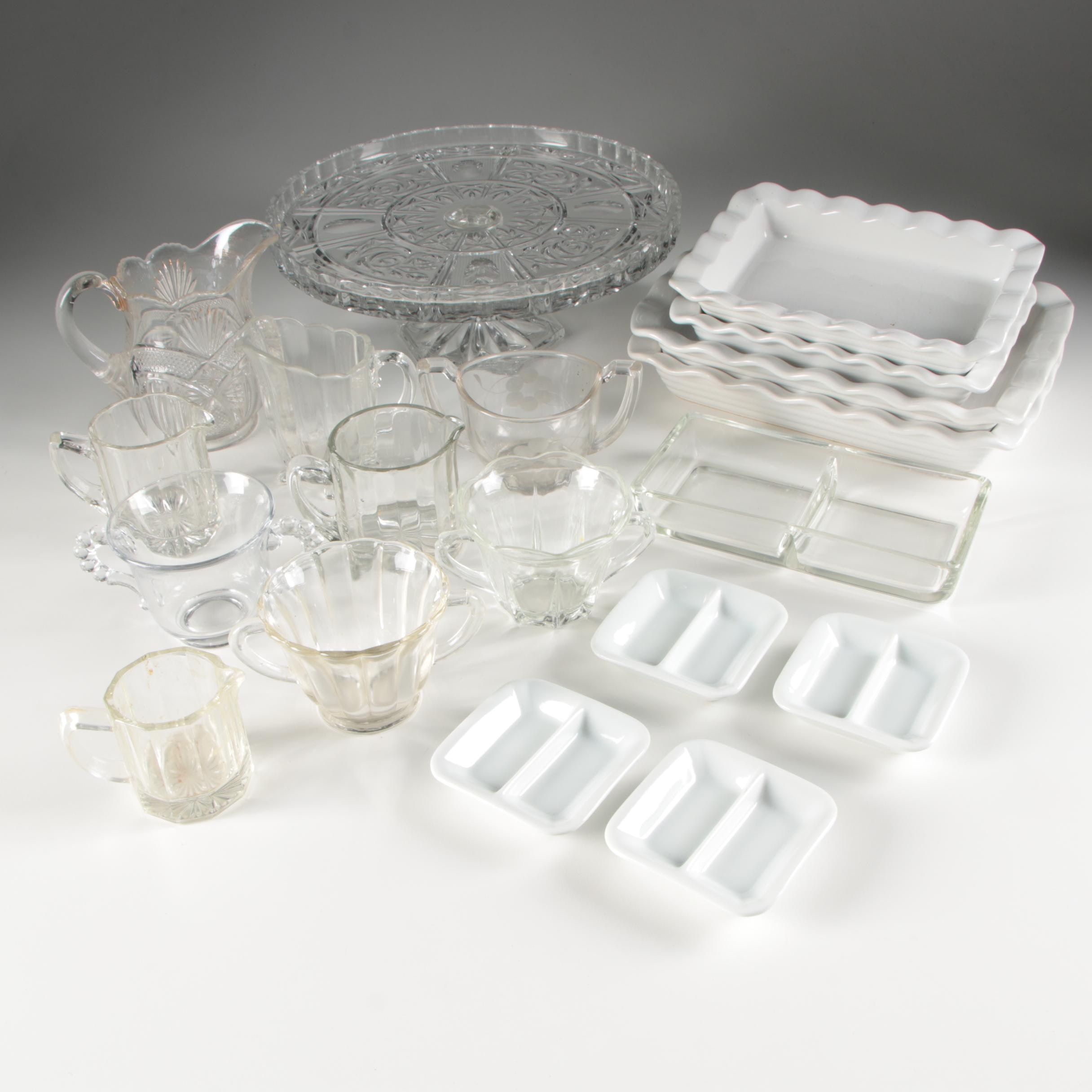 Ceramic Serving Trays, Cake Stand, and a Collection of Glass Creamers and Sugars
