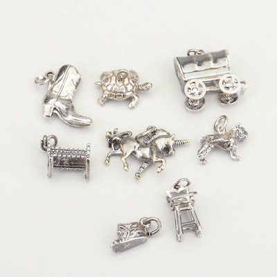 Eight Sterling Silver Charms