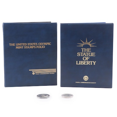 Olympics and Statue of Liberty Stamp Albums with Two Commemorative Dollars