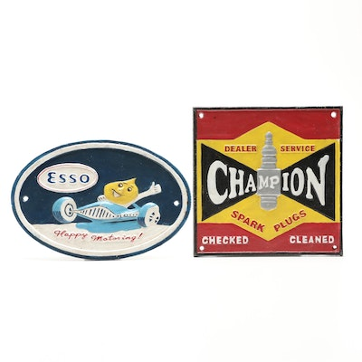 Champion and Esso Cast Iron Advertising Signs