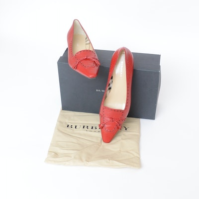 Burberry Grained Red Leather Low-Heeled Pumps with Tassels and Black Stitching