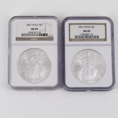 Two NGC Graded MS69 2001 and 2002 American Silver Eagles