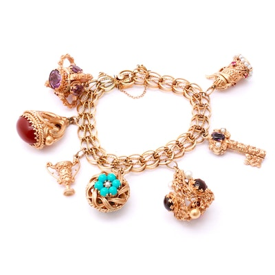 14K and 10K Yellow Gold Charm Bracelet with Garnet, Turquoise, Pearl, and More