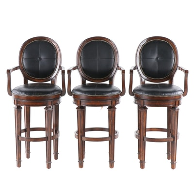 Three Contemporary Wooden Swivel Bar Chairs with Black Upholstered Seats