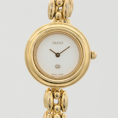 Gucci 11/12 Gold Tone Quartz Wristwatch With Interchangeable Bezel