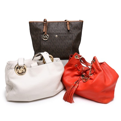 MICHAEL Michael Kors Leather Handbags with Jet Set Tote in Coated Canvas