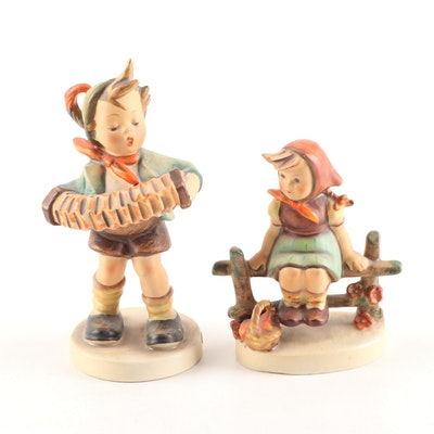 "Hummel Porcelain Figurines ""Accordian Boy"" and ""Just Resting"""
