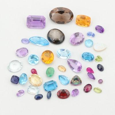Loose 83.82 CTW Smoky Quartz, Black Star Sapphire, and Citrine Gemstones