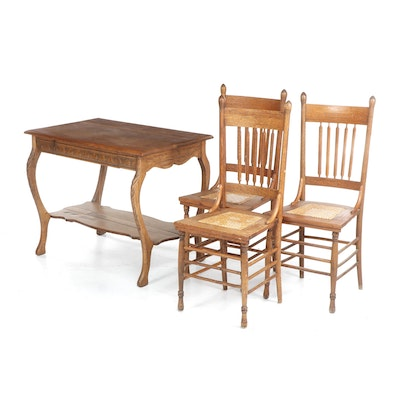 Victorian Style Oak Table and Three Caned Side Chairs