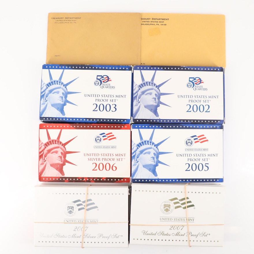 Eight U.S. Mint Proof Sets Including Two Silver Sets