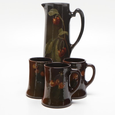"""Owens Pottery """"Utopian"""" Tall Pitcher and Mugs with Cherries, Early 20th Century"""