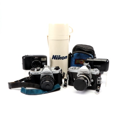 Vintage Cameras and Nikon Thermos Featuring Pentax K1000