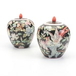 Pair of Chinese Famille Noire Lidded Jars with Bird and Floral Motif