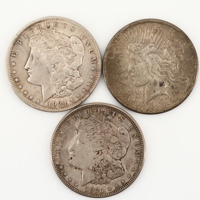 Three U.S. Silver Dollars Including 1925 Silver Peace Dollar