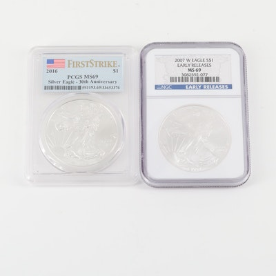 Two Graded One Dollar U.S. Silver Eagles