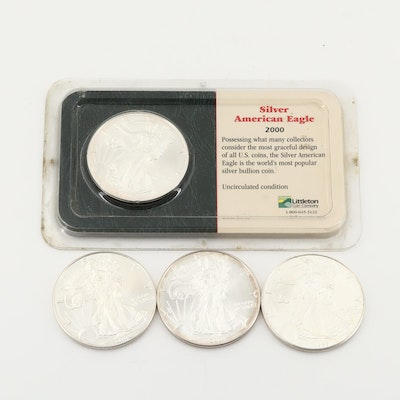 Four $1 U.S. Silver Eagles Including 1999, 2000, 2001, and 2002