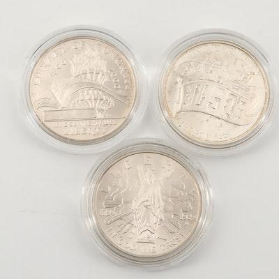 Three U.S. Commemorative Silver Dollars
