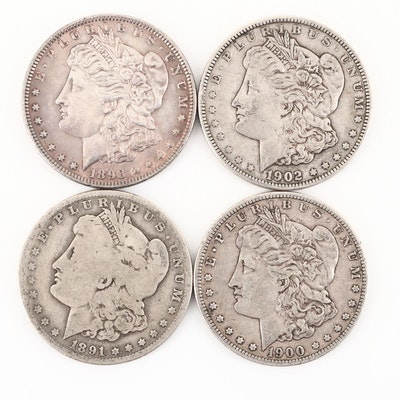 Four Silver Morgan Dollars Including an 1891-O