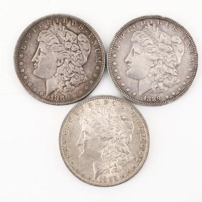 Three Silver Morgan Dollars Including an 1883-O, 1886, and 1889