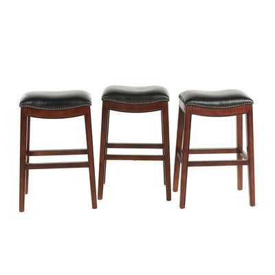 Three Contemporary Faux Leather Upholstered Wooden Barstools