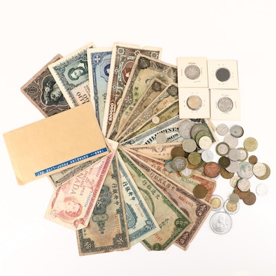 Assortment of Vintage Foreign Coins and Currency