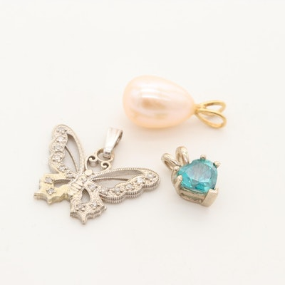 Collection of 14K Gold Pendants with Butterfly and Triangle Pendants