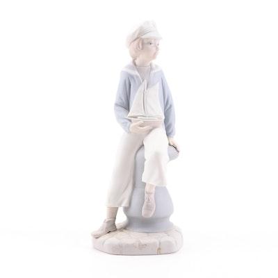 "Lladró ""Boy with Yacht"" Porcelain Figurine"