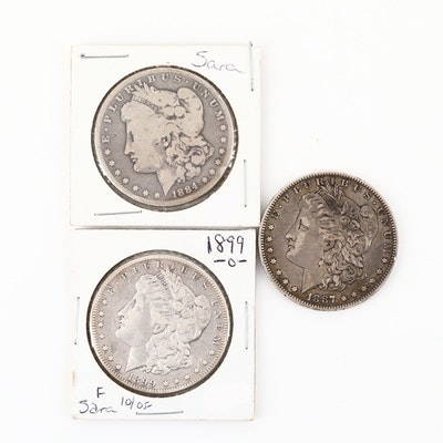 Three Silver Morgan Dollars: 1884, 1887-O, and 1899-O