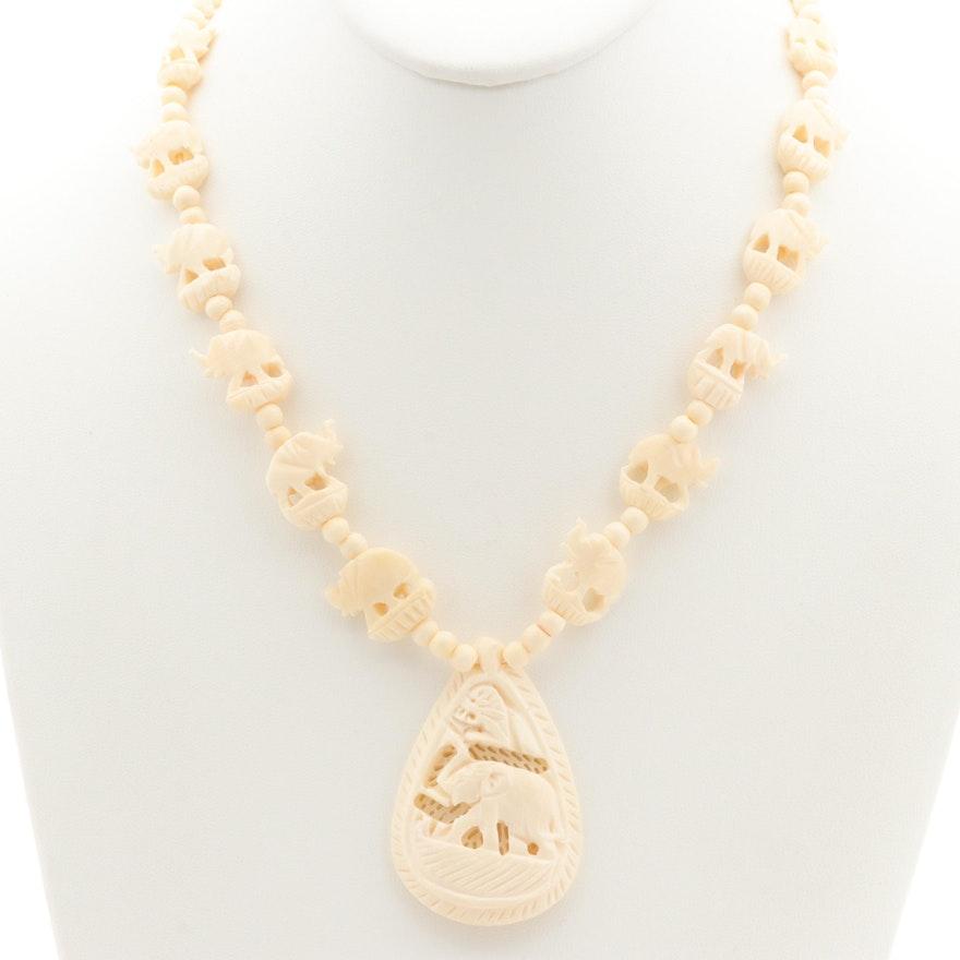 14k Yellow Gold Bone Carved Elephant Necklace Ebth