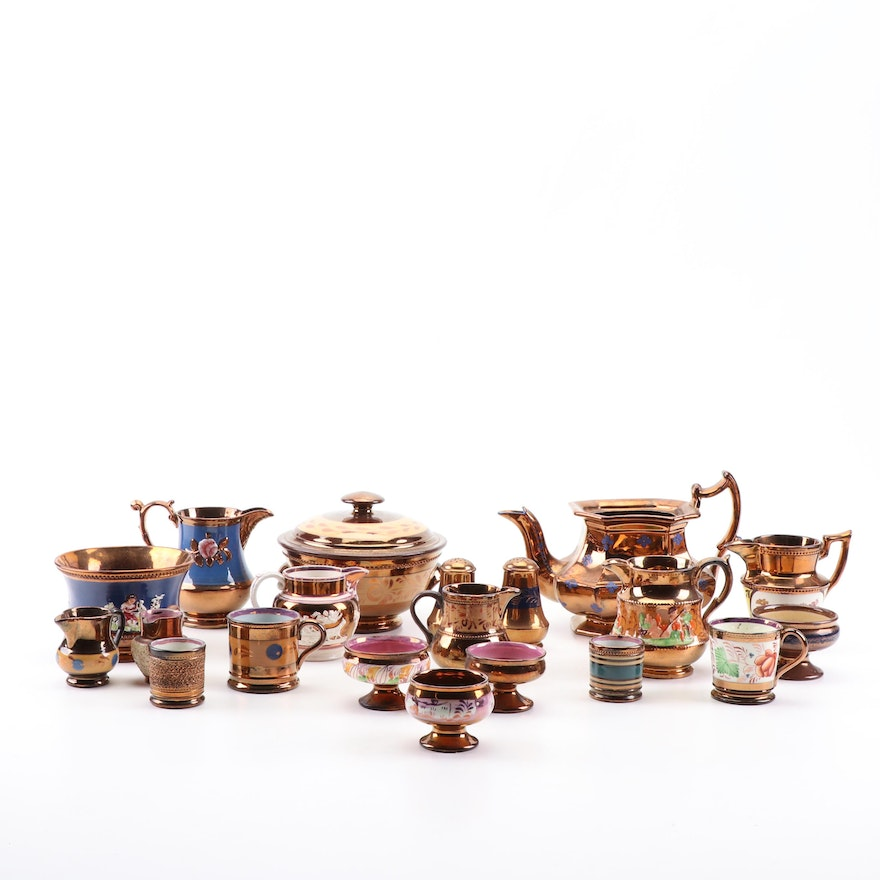 Copper Lusterware Tableware Including Pitchers and Condiment Dishes, 19th C.