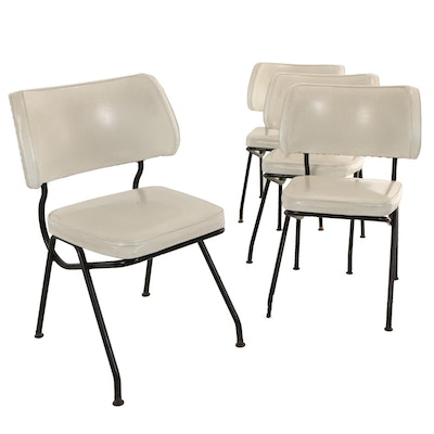 Four Mid Century Modern White Naugahyde and Ebonized Tubular Steel Side Chairs