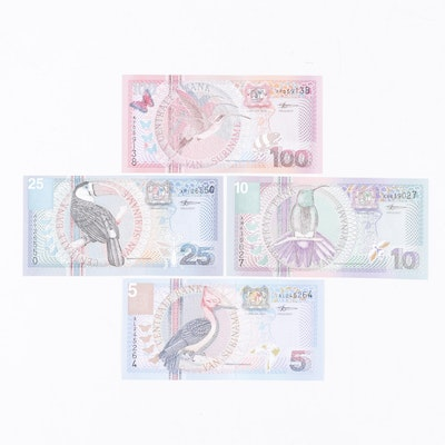 Group of Four Suriname Foreign Currency Banknotes