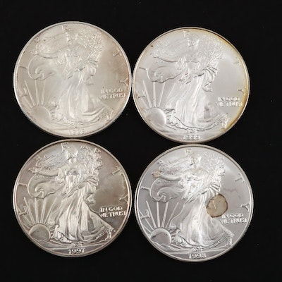 Four One Dollar U.S. Silver Eagles Featuring a 1995 and 1999