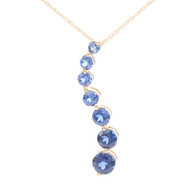14K Yellow Gold Blue Sapphire Journey Pendant Necklace