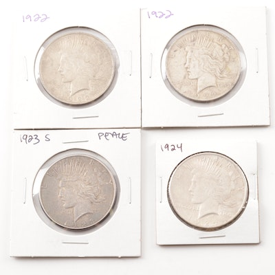 Four Silver Peace Dollars Including Two 1922, 1923 S, and 1924
