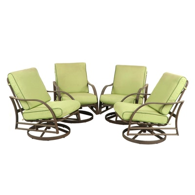 Four Swivel Metal Patio Armchairs