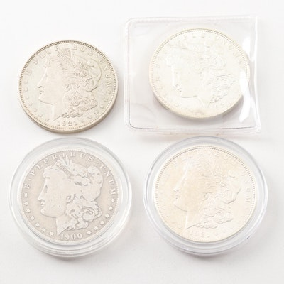 Four Morgan Silver Dollars Including 1900-O, 1921 and 1921-D
