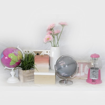 Collection of Decor including Globes, Candy Machine, and Artifical Plants