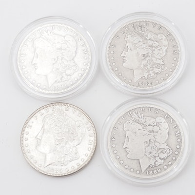 Four Silver Morgan Dollars Including 1885, 1885-O, 1889-O, and 1891-O