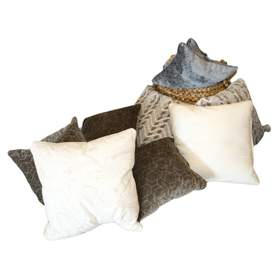 Grouping of Decorative Throw Pillows with Woven Basket