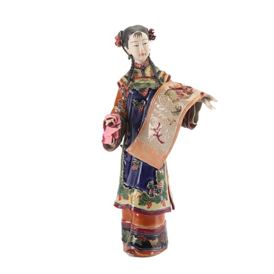 Chinese Porcelain Figurine with Scroll
